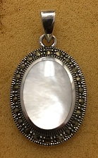 Sterling Silver Oval Mother Of Pearl Pendant With Marcasite